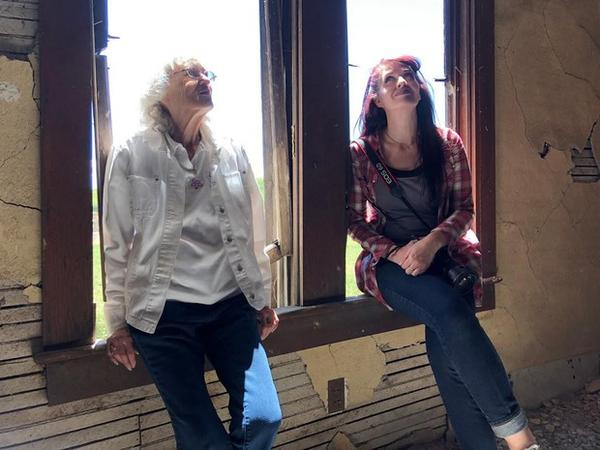 <p>Ellen Simmons and Danielle Denham take a moment to listen to the sounds inside the empty Nelson House</p>