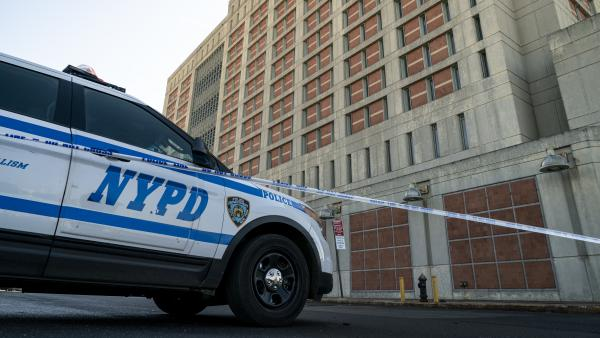 An NYPD vehicle sits outside the Metropolitan Detention Center in Brooklyn on Monday. Inmates inside suffered days of bitter cold without heat in the facility.