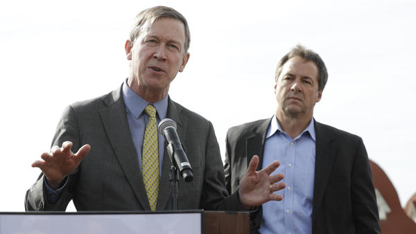 Then-Colorado Gov. John Hickenlooper (left) and Montana Gov. Steve Bullock at a 2016 Western Governors' Association meeting in Coronado, Calif. They are two Democrats considering running for president in 2020 with a message of pragmatism and bipartisan accomplishment.