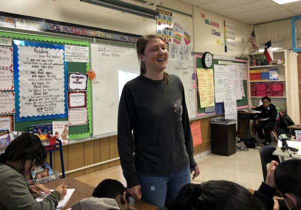 Gates Elementary teacher Kayla John laughs at a drawing a student drew of her during guided reading in January 2019. San Antonio ISD pays her an extra $15,000 stipend as a master teacher.