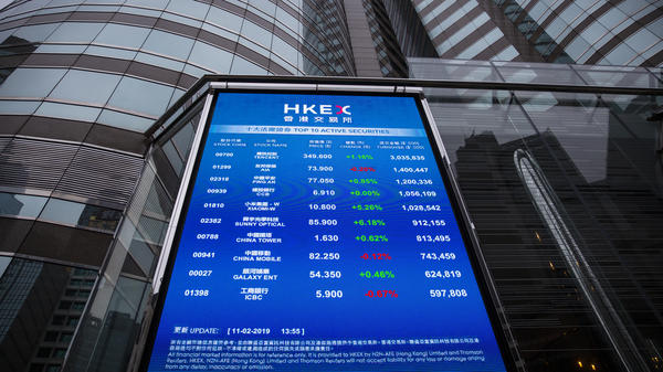Stock figures of the top 10 active securities are displayed outside the Exchange Square complex, which houses the Hong Kong Stock Exchange, in Hong Kong on Monday. Asian markets closed mostly higher ahead of U.S. China talks.