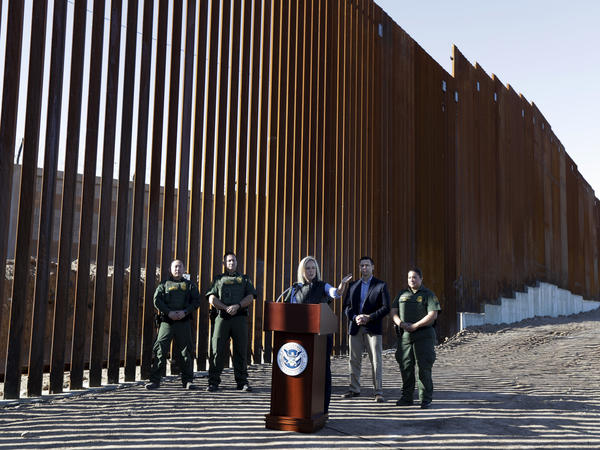 U.S. Department of Homeland Security Secretary Kirstjen Nielsen speaks in front of a newly fortified border wall structure in Calexico, Calif. in October. A federal court ruled Monday that DHS has broad authority to waive environmental regulations in the name of border security.