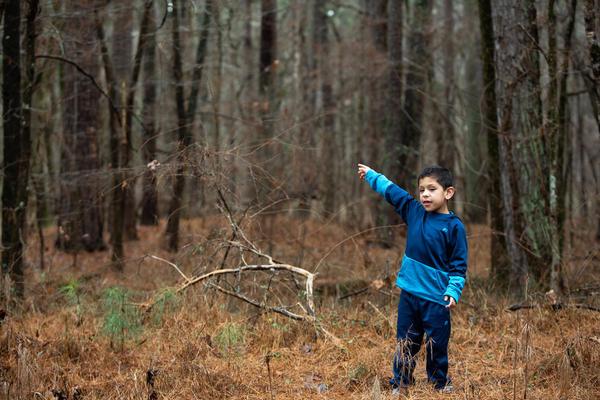 Roan Fields-Moffitt walks through a wooded area adjacent to Murdoch Developmental Center in Butner, N.C. on Thursday, Jan. 3, 2019.
