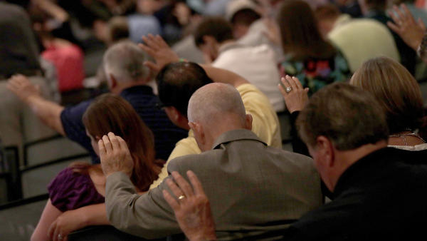 People pray during the Southern Baptist Convention annual meeting in Phoenix in 2017.