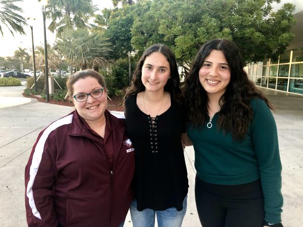 Marjory Stoneman Douglass Journalism Teacher Sarah Lerner, student Leni Steinhardt, 17 and student Nadia Murillo, 16 stand in front of the Northwest Regional Library in Coral Springs.