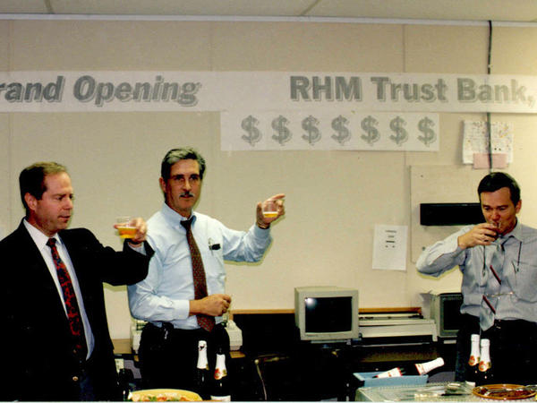 Special agents celebrate their fake offshore bank with apple juice.