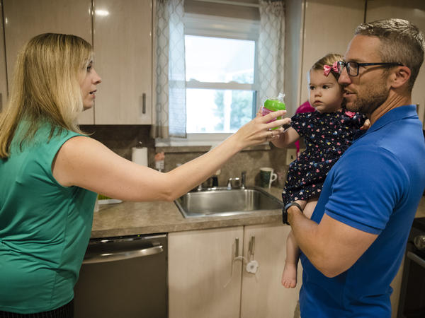 Lauren Woehr hands her 16-month-old daughter Caroline a cup filled with bottled water at their home in Horsham, Pa. EPA testing has found significant amounts of harmful PFAS chemicals in public water supplies in 33 U.S. states.