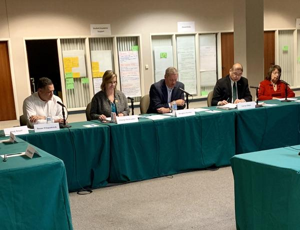 Board members prepare to vote on tentative contract agreement at February 11 meeting.