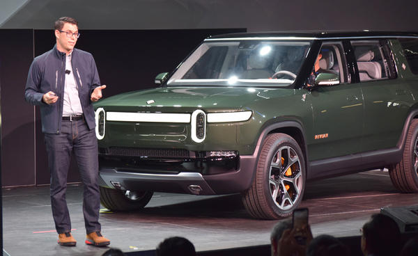 Rivian Founder and CEO RJ Scaringe unveiled the company's  R1S SUV at the LA Auto Show in November.
