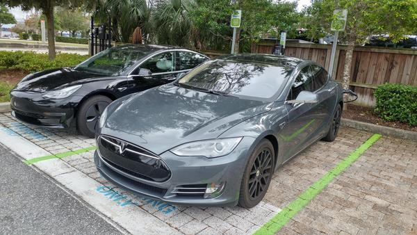 A Tesla Model 3 (left) and Model S charge at the Cummer Museum and Gardens parking lot.