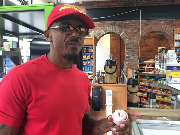 Mark Schand scoops ice cream at his Sweetwater smoothie cafe in New Britain, Conn. This business is meant to reboot a career Schand says was stolen from him at the age of 19 when he was wrongfully convicted of a crime and was imprisoned for 27 years.