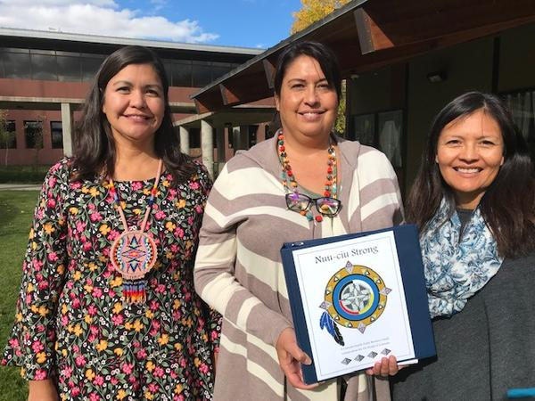 "LaTitia Taylor, Education Director from the Southern Ute tribe and members of the tribe holding Colorado's new native curriculum, called ""Nuu-ciu Strong."" ""Nuu-ciu"" means the Ute people."