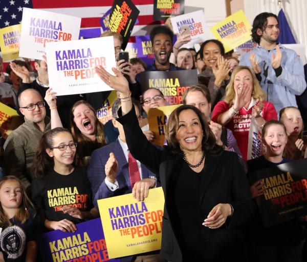 Kamala Harris greets a large crowd at a rally in Portsmouth