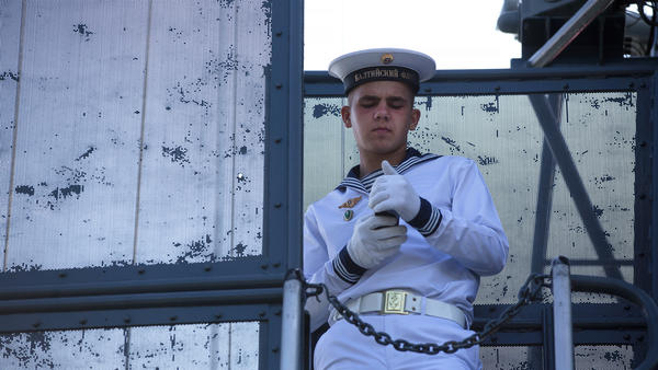 A Russian sailor checks his smartphone aboard a warship while supervising visitors during Russian Navy day at the Vistula lagoon in Baltiysk, Russia, in 2016. On Tuesday, Russian lawmakers passed a bill restricting service members from using smartphones.