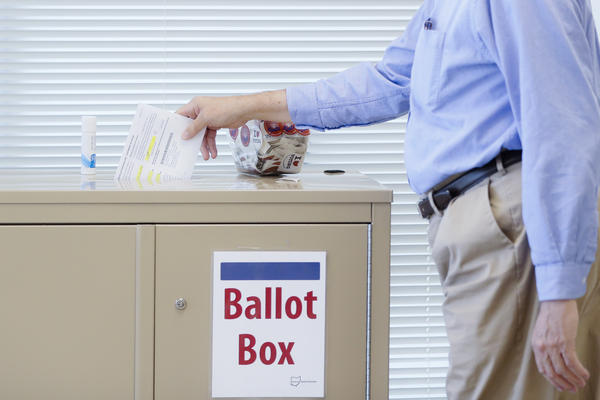 A voter casts an early ballot at the Hamilton County Board of Elections.