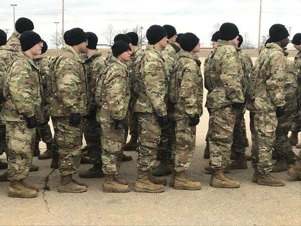 New recruits line up for outdoor lunch on a cold and windy day at Fort Leonard Wood. Some of them are wearing the current version of the boots, others are testing new designs.