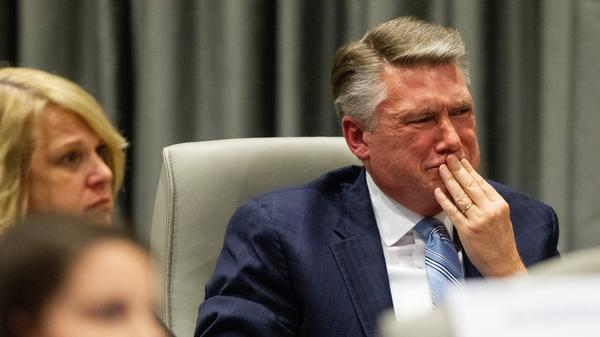 Mark Harris, Republican candidate in North Carolina's 9th Congressional race, fights back tears at the conclusion of his son John Harris's testimony during the third day of a North Carolina State Board of Elections hearing on the 9th Congressional District voting irregularities.