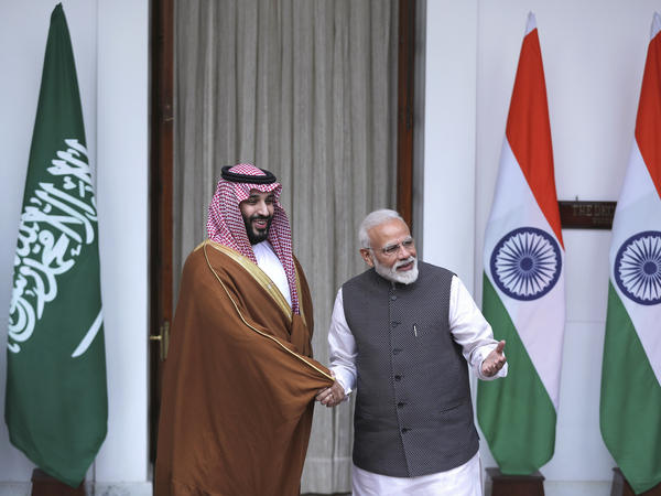 Indian Prime Minister Narendra Modi, right, shakes hands with Saudi Crown Prince Mohammed bin Salman before the start of their meeting in New Delhi, on Wednesday.