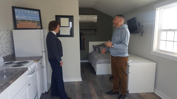 Veterans Community Project co-founder Chris Stout leads U.S. Rep Vicky Hartzler on a tour of the facility. This tiny house is one that will house veterans transitioning out of homelessness.