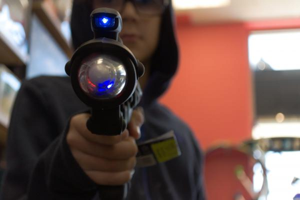 Brooks Creighton, 10, holds a Space Blaster toy at  Learning Express Toys & Gifts in Durham, North Carolina. He says he's grown up with BB guns and nerf guns in his home.