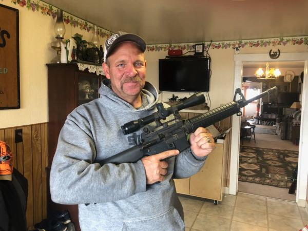 Of the dozens of firearms Scott Shepherd owns, he says the AR-15 is probably his favorite.
