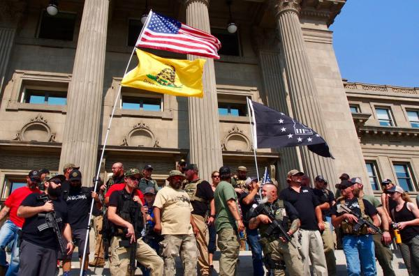 "Gun rights activists, including members of the anti-government group The Three Percenters, stand on the steps of the Idaho State Capitol during a gun rights rally in September 2018. Three Percenters have been part of an effort by ""no compromise"" gun rights activists to make it harder to prosecute those who claim self-defense in shootings under proposed ""stand your ground"" bills."