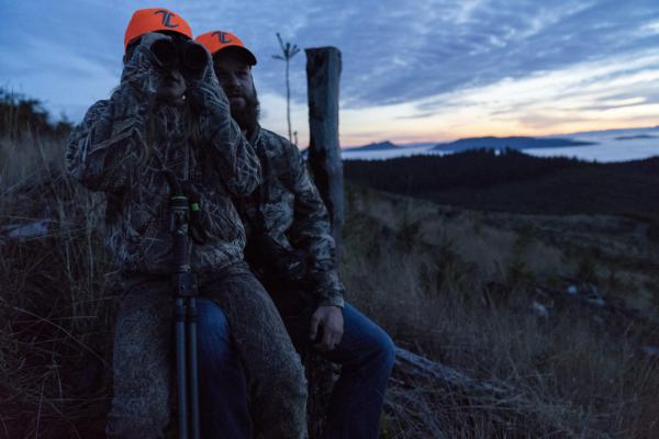 Taylor Tiller, 10, sits with her her father, Tyler. Hunting trips are a family tradition and a way for Taylor to learn about responsibility, the environment and self-confidence.