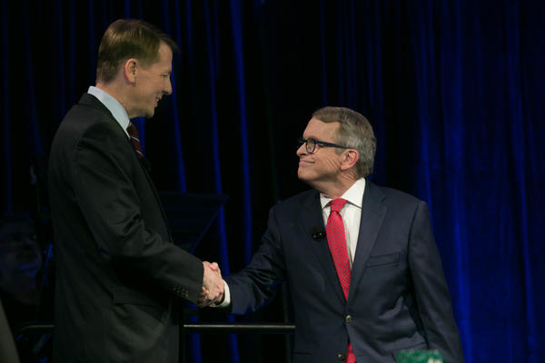 Democrat Richard Cordray (left) and Republican Mike DeWine shake hands before the final gubernatorial debate, sponsored by the Ohio Debate Commission.