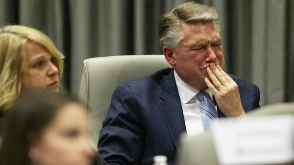 Mark Harris, Republican candidate in North Carolina's 9th Congressional race, fights back tears at the conclusion of his son John Harris' testimony during a public evidentiary hearing on the 9th Congressional District voting irregularities investigation last week.