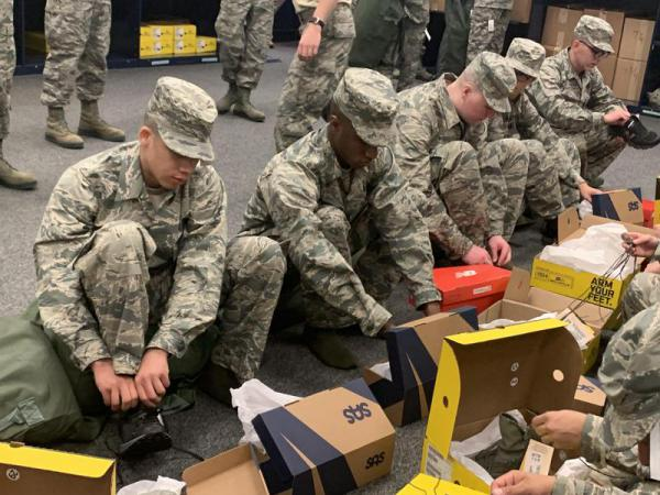 New Air Force recruits try on shoes from San Antonio Shoemakers, Propper Footwear and New Balance. The Defense Department has been issuing the shoes since January.