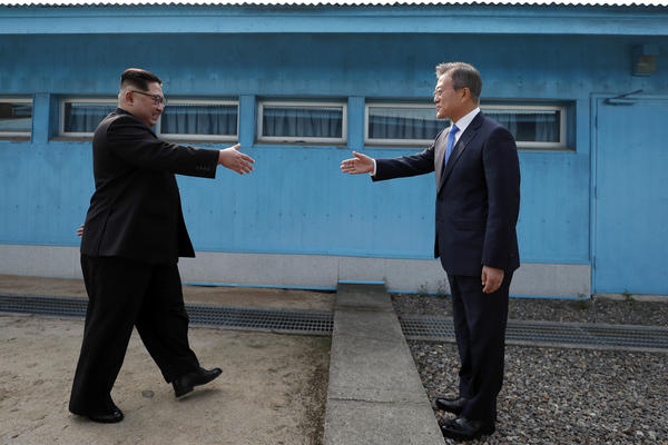 Kim approaches from the northern side as Moon is on the southern side of the military demarcation line upon meeting for the Inter-Korean Summit on Friday.