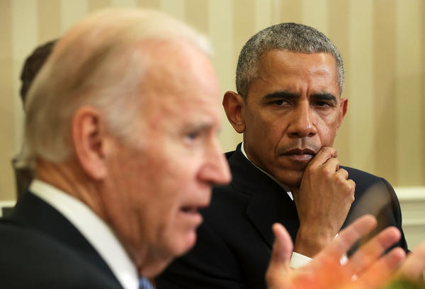 President Barack Obama and Vice President Joe Biden, pictured here in the Oval Office in 2016, reunite as a buddy-cop crime-solving duo in the new (entirely fictional) novel <em>Hope Never Dies.</em>