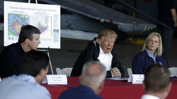 President Trump speaks while attending a briefing at Marine Corps Air Station Cherry Point in Havelock, N.C., on Wednesday, during a trip to visit areas impacted by Hurricane Florence. North Carolina Gov. Roy Cooper (left) and Homeland Security Secretary Kirstjen Nielsen (right) also attended the briefing.