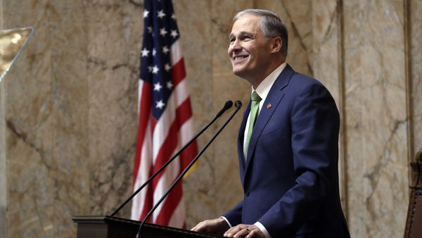 Washington Gov. Jay Inslee gives his State of the State address to a joint session of the Legislature on Jan. 15, 2019, in Olympia, Wash.