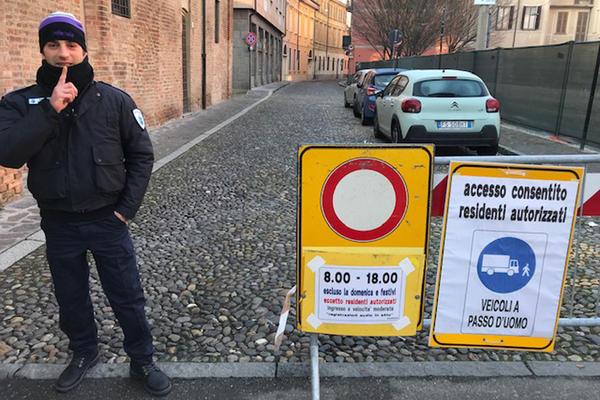 A security guard blocks off the recording area outside the Violin Museum in Cremona, Italy.
