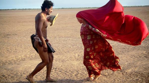 Rapayet (José Acosta) and Zaida (Natalia Reyes) perform a public dance in<em> Birds of Passage.</em>