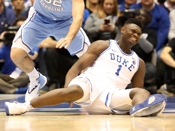 Duke's Zion Williamson reacts after falling as his shoe breaks in the game against the North Carolina Tar Heels Wednesday in Durham, N.C.