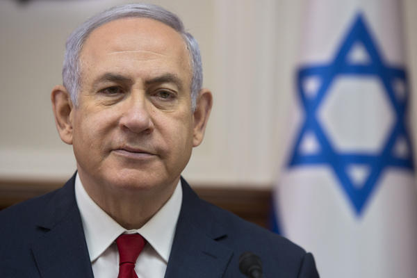 Israel's attorney general says he is taking steps to indict Israeli Prime Minister Benjamin Netanyahu, shown here earlier this month, on corruption charges.