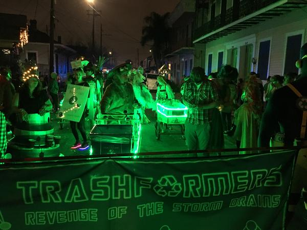 The Trashformers beg parade goers for recyclable waste during the krewedelusion parade on Saturday, February 16th, 2019
