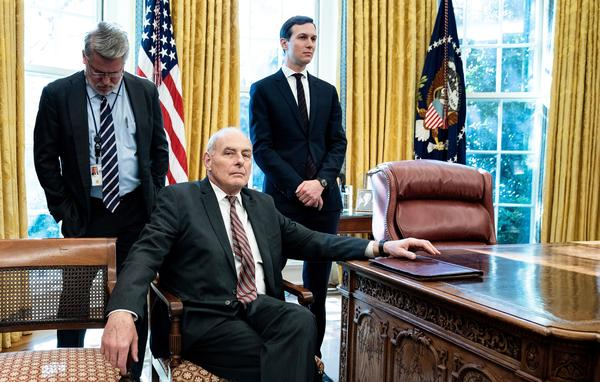 White House communications official Bill Shine (left), then-White House chief of staff John Kelly and senior adviser Jared Kushner wait in the Oval Office in December 2018. <em>The New York Times</em> reports that Kelly opposed Kushner's security clearance, but President Trump overruled him and others.