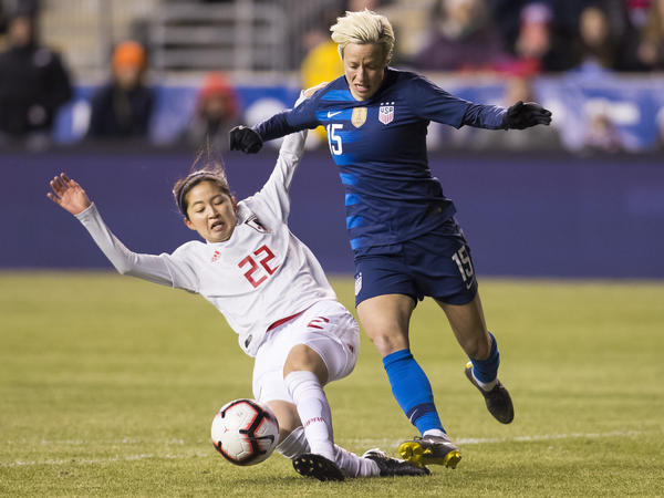U.S. Women's National Soccer Team forward Megan Rapinoe, right, tries to get around Japan's Risa Shimizu, left, with the ball during the first half of SheBelieves Cup soccer match, Wednesday, Feb. 27, 2019, in Chester, Pa. The U.S. tied Japan 2-2 in a friendly match in the run-up to the World Cup in June.