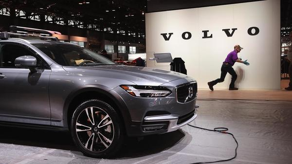 Volvo said it will limit all its new cars to a top speed of about 112 mph, starting in 2020. Here, workers on Feb. 6 prepare the Volvo display before the opening of the Chicago Auto Show.