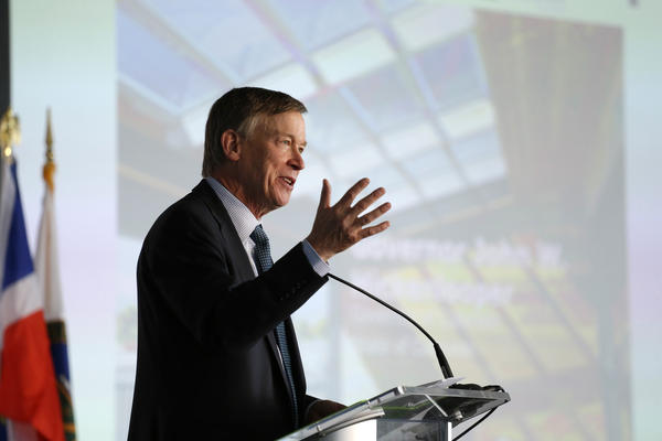 Then-Gov. John Hickenlooper speaks at the U.S. Department of Energy Solar Decathlon 2017 opening ceremony in Denver, Colorado on Oct. 5, 2017.