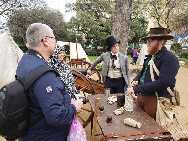 Re-enactors interact with visitors.