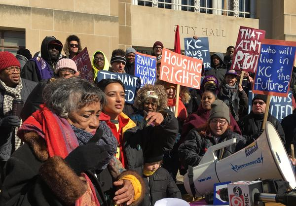 Protesters brave bitter cold temperatures to rally for tenant's rights on the steps of City Hall Monday.