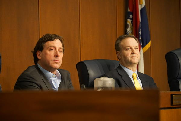 St. Louis County Executive Steve Stenger (left) and Councilman Sam Page (right) attend a county council meeting Tuesday night. A new resolution calls on the prosecuting attorney to look into if Stenger violated county charter.