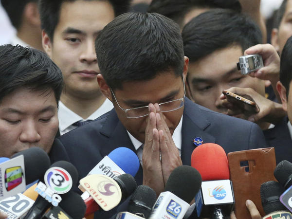 Preechapol Pongpanich, leader of the Thai Raksa Chart political party, speaks with media at the Constitutional Court in Bangkok on Thursday. The court ordered the dissolution of the party, days before Thailand's elections.