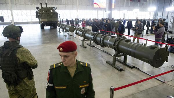 Russian military officers stand by as the 9M729, center, its launcher, left, and the 9M728, right, land-based cruise missiles are displayed in Kubinka outside Moscow, in January. The Russian military rolled out its new missile and spelled out its specifications, seeking to dispel the U.S. claim that the weapon violates the INF Treaty.