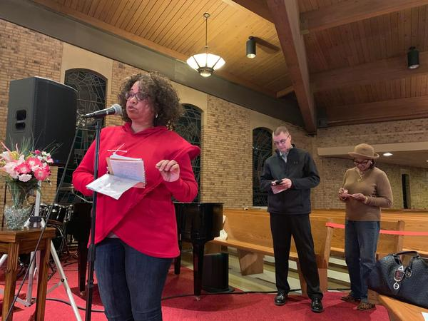 Gail Woods (left) and others ask questions at the Better Together Town Hall at Greater St. Mark Family Church. The event is one of several town halls that will be hosted by the organization.