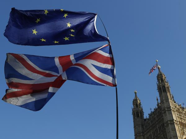 Flags of the European Union and Great Britain are flown during a demonstration in London on Feb. 27. Prime Minister Theresa May's plan was voted down in Parliament on Tuesday.
